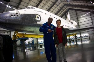 Ryan Bean of Scotts Valley, California winner of the Space Container Challenge with Astronaut Leland Melvin during tour of the Space Shuttle Endeavour at the California Science Center.