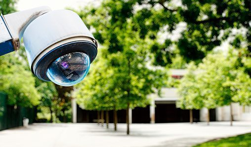 A security camera overlooks the area outside of a school.
